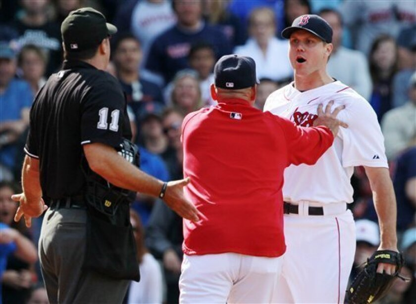 Boston Red Sox manager Terry Francona, center, restrains pitcher Jonathan Papelbon, right, as he argues with the home plate umpire Tony Randazzo in the ninth inning of a baseball game against the Oakland Athletics in Boston, Saturday, June 4, 2011. Papelbon was ejected. (AP Photo/Michael Dwyer)