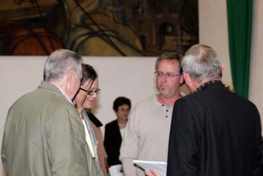 Nancy Warwick and Bob Grassa talk to La Jollans Tom Brady and Oren Gabsch. Photo: Kathy Day