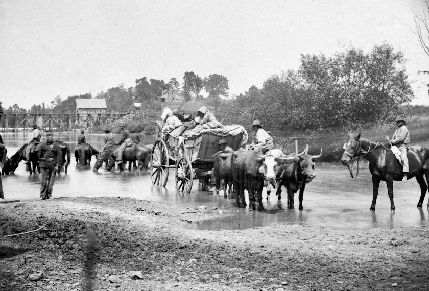 A wagon team of fugitive African Americans, Union soldiers and North supporters head for safety across the Rappahannock River in eastern Virginia.