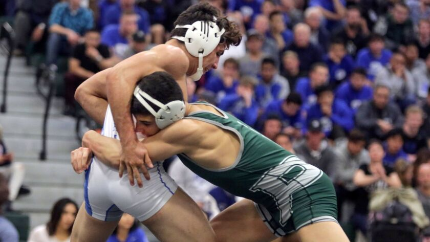 Poway's Domonic Mata (right) is ranked No. 1 in the state at 152 pounds.
