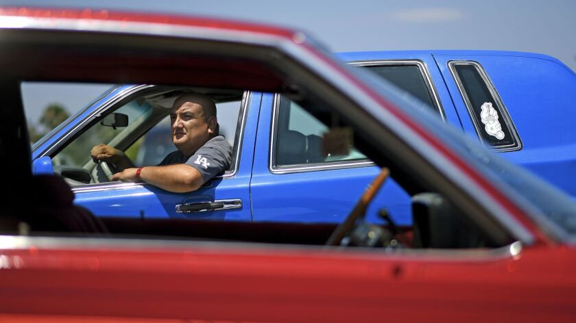 LOS ANGELES-CA-JULY 23, 2017: Eli Garcia of La Puente is photographed with his car during the Torres