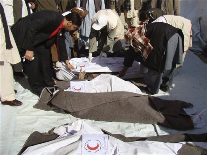 The bodies of Taliban fighters, who were killed in Friday's gunbattle with Afghan forces, are covered with blankets at the office of Afghan Red Crescent Society to be transported to their villages, in Lashkar Gah, capital of Helmand province, south of Kabul, Afghanistan, Sunday, Jan. 31, 2010. (AP Photo/Abdul Khaleq)