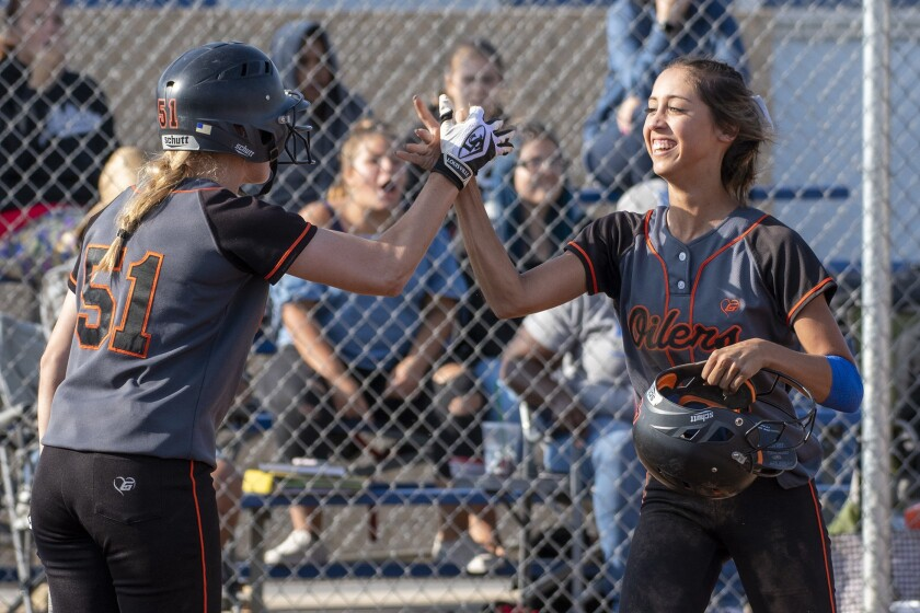 Huntington Beach's Shelbi Ortiz is given the run on an obstruction call at the plate in a CIF Southern Section Division 1 quarterfinal game on May 24, 2018.