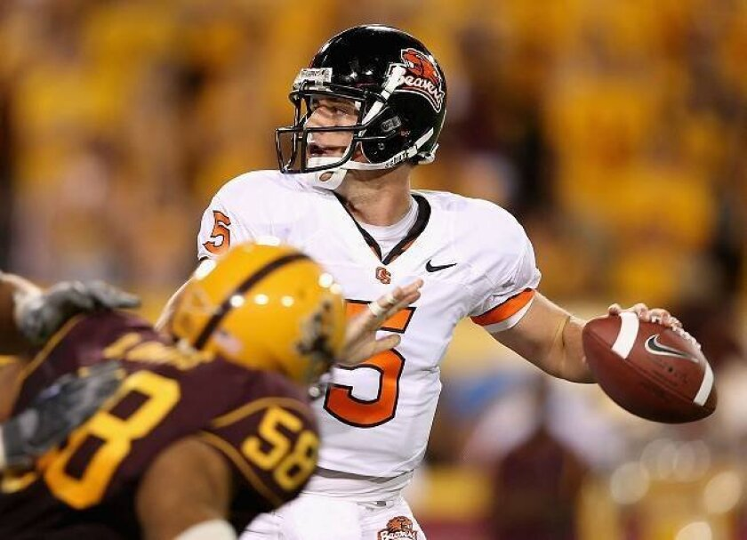 Sean Canfield, shown as Oregon State quarterback, has come a long way since his days at Carlsbad High.