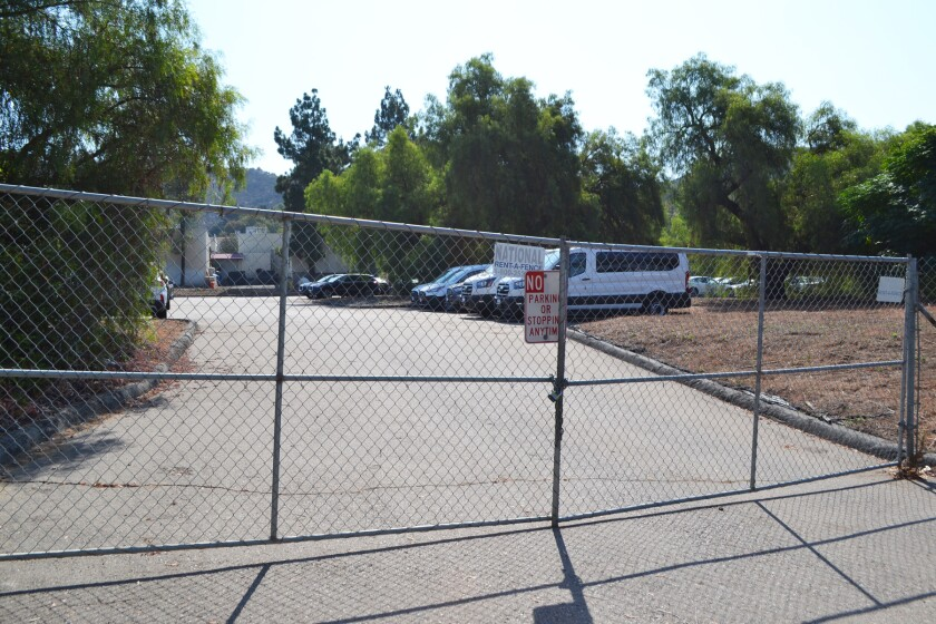 The City of Poway's Monte Vista Road property is used as a parking lot, but could be affordable housing in the future.