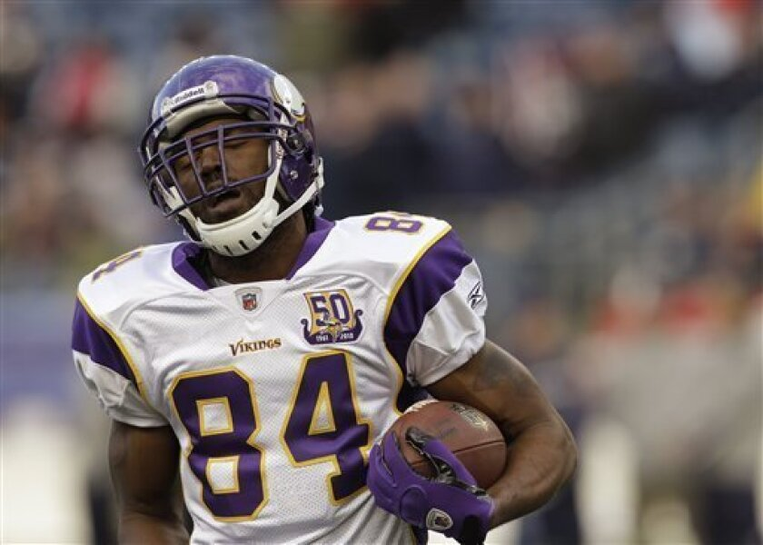 In this Sunday, Oct. 31, 2010, photo, Minnesota Vikings wide receiver Randy Moss runs with a ball during warmups for an NFL football game against the New England Patriots in Foxborough, Mass. Vikings players confirmed Monday that coach Brad Childress informed them during a team meeting that Moss had been let go. (AP Photo/Stephan Savoia)
