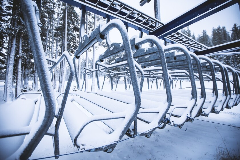 Lift chairs are buried in snow Monday at Mt. Rose Ski Tahoe.
