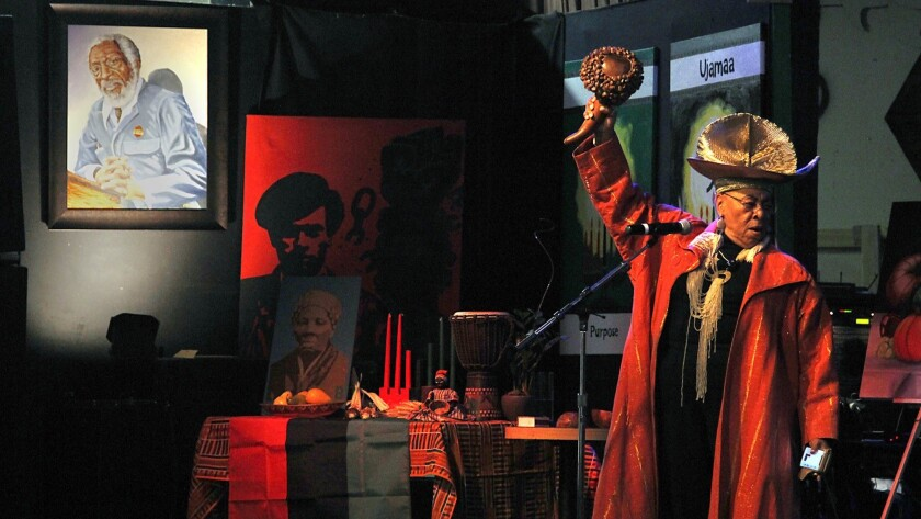 Alyce Smith Cooper spoke about Ujamaa, one of the seven principles of Kwanzaa, which highlights cooperative economics. Kwanzaa was celebrated at the World Beat Center San Diego in Balboa Park Saturday night with spoken word, storytelling and music.