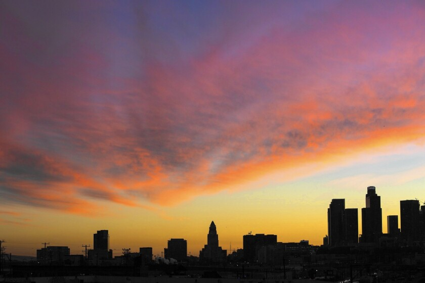 Sunset above downtown L.A. on Jan. 28. As of Friday afternoon, downtown had recorded 6.54 inches of rain, 91% of average.