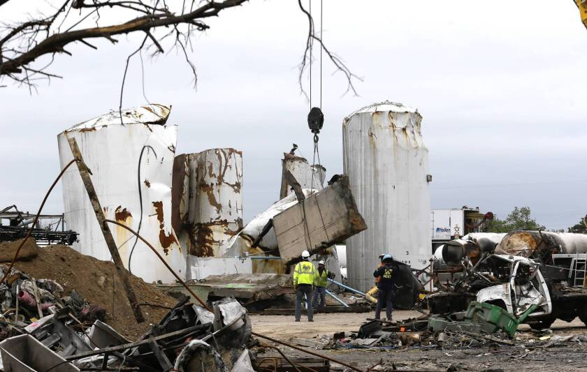 Investigators search debris at the site of a deadly fertilizer plant fire and explosion in West, Texas. A paramedic who responded to the blaze has been arrested for having materials to make a pipe bomb, but officials won't confirm any link to the April 17 explosion.