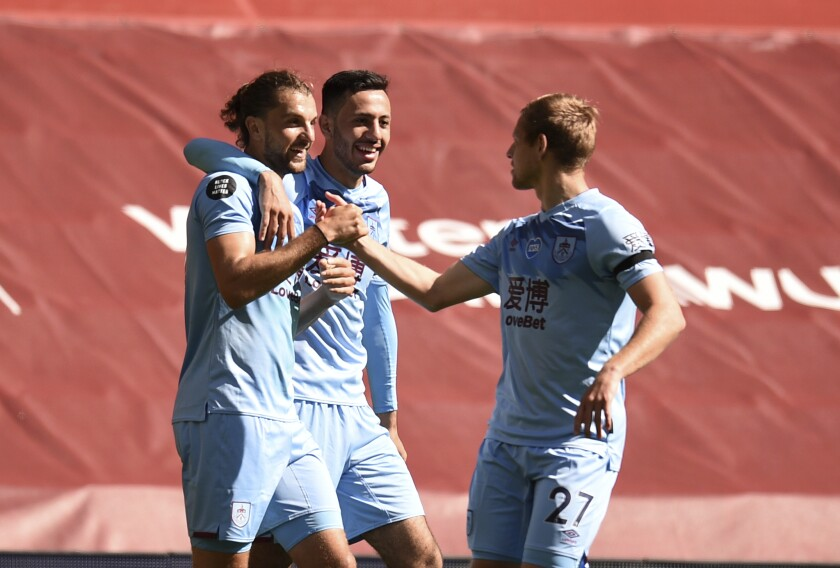 Burnley's Jay Rodriguez, left celebrates with teammates after scoring his sides first goal during the English Premier League soccer match between Liverpool and Burnley at Anfield, Liverpool, England, Saturday, July 11, 2020. (Oli Scarff/ Pool via AP)