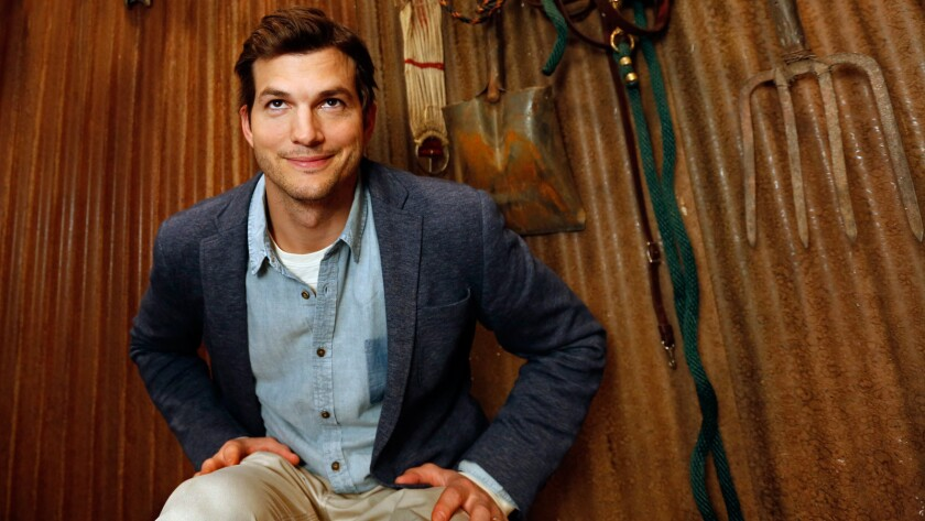"""Actor Ashton Kutcher sits on the set where his new Netflix series, """"The Ranch,"""" is being filmed at the Warner Brothers lot in Burbank on March 22, 2016."""