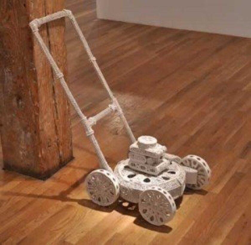 Glazed porcelain lawnmower by Susan Graham, in studio Sept.6-Oct. 6, on exhibit through Oct. 27.