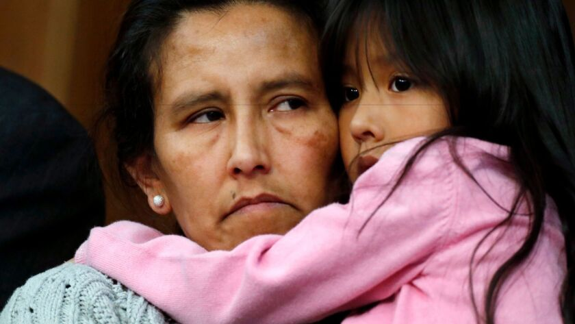 Jeanette Vizguerra, a Mexican woman seeking to avoid deportation from the United States, cradles her 6-year-old daughter, Zury, during a news conference Feb. 15 at a church in Denver where she and her children have taken refuge.