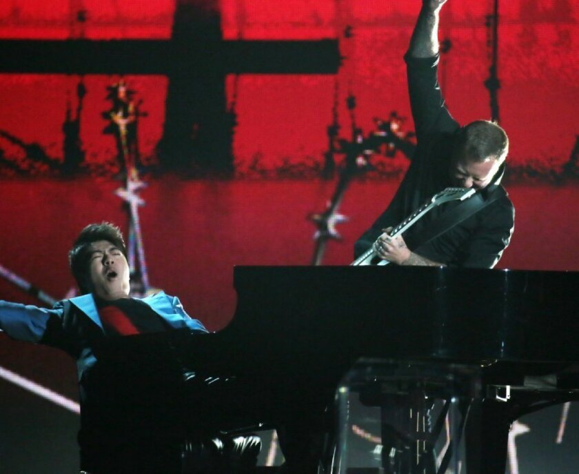 Pianist Lang Lang performs with James Hetfield of Metallica at the Grammy Awards at Staples Center in Los Angeles.