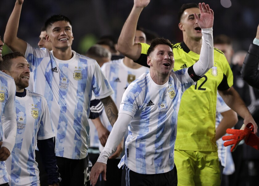 Argentina's players celebrate at the end a qualifying soccer match for the FIFA World Cup Qatar 2022