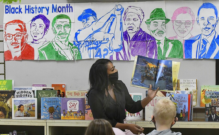 Grove Elementary School teacher Cameo Williams reads a book about Harriet Tubman.