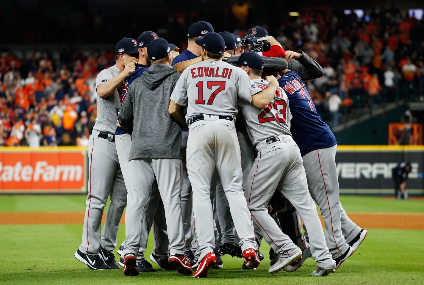HOUSTON, TX - OCTOBER 18: The Boston Red Sox celebrate defeating the Houston Astros 4-1 in Game Five of the American League Championship Series to advance to the 2018 World Series at Minute Maid Park on October 18, 2018 in Houston, Texas. (Photo by Bob Levey/Getty Images) ** OUTS - ELSENT, FPG, CM - OUTS * NM, PH, VA if sourced by CT, LA or MoD **