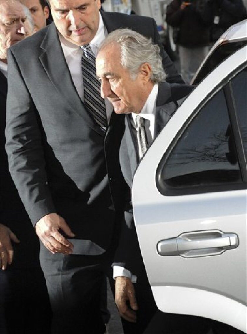 FILE - In this March 12, 2009 file photo, Bernard Madoff arrives at Manhattan federal court in New York. A year after Madoff's multibillion-dollar investment scheme collapsed, investigators and investors are still struggling to measure the full scope and impact of the largest securities fraud in history.(AP Photo/ Louis Lanzano, file)