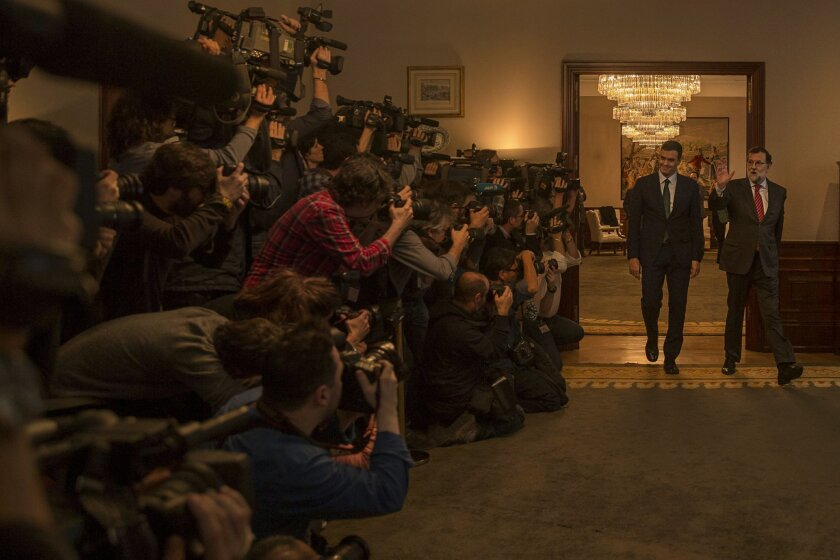 Spain's acting Prime Minister Mariano Rajoy, right, and main Socialist opposition leader Pedro Sanchez walk inside the room for a meeting at the Spanish Parliament  in Madrid Friday, Feb. 12, 2016 . (AP Photo/Daniel Ochoa de Olza)