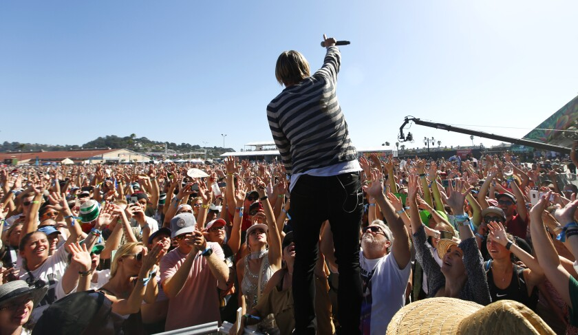 Jon Foreman of the band Switchfoot goes into the crowd at the Sunset Cliffs stage at KAABOO Del Mar on Saturday, Sept. 14, 2019.
