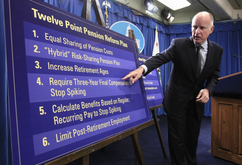 Gov. Jerry Brown gestures to a chart in 2011 showing proposals to roll back public employee pension benefits