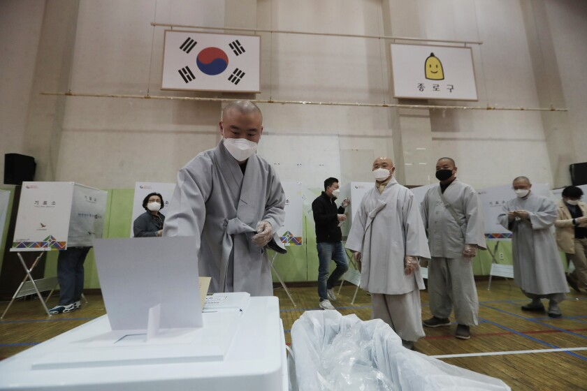 A Buddhist monk casts his early vote in South Korea's parliamentary elections.