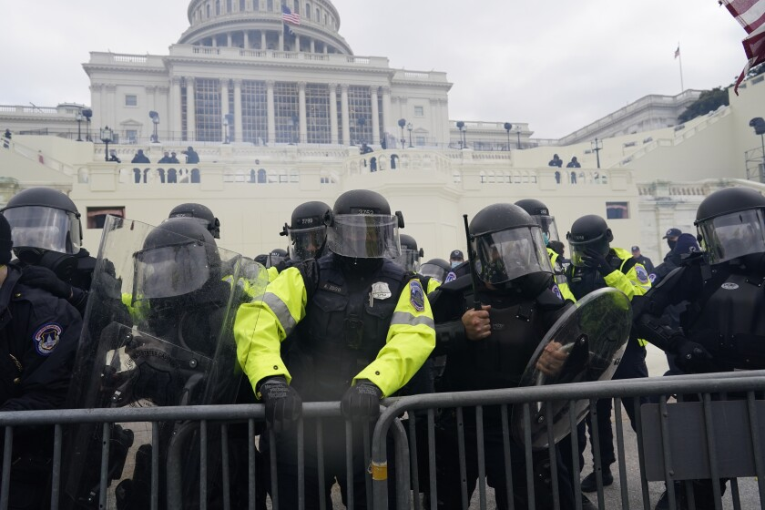 Police try to hold back protesters in front of the U.S. Capitol in Washington on Jan. 6.
