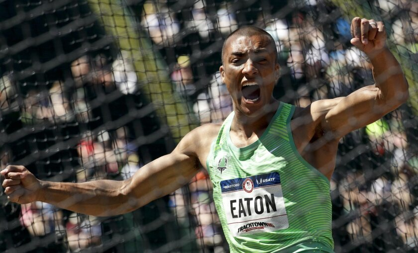 FILE - In this July 3, 2016, file photo, Ashton Eaton reacts during the decathlon discus event at the U.S. Olympic Track and Field Trials in Eugene, Ore. Eaton is a hot favorite to win another prize for most versatile athlete at the Olympics. (AP Photo/Charlie Riedel, File)