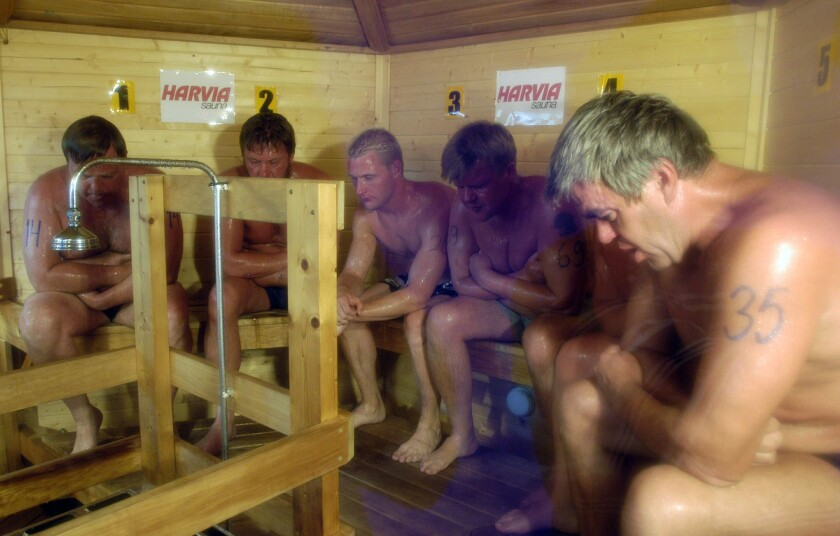 In this Aug. 2, 2003, photo, competitors sweat it out during the Sauna World Championships in Heinola, Finland. Frequent sauna baths may help you live longer, a study of Finnish men suggests.
