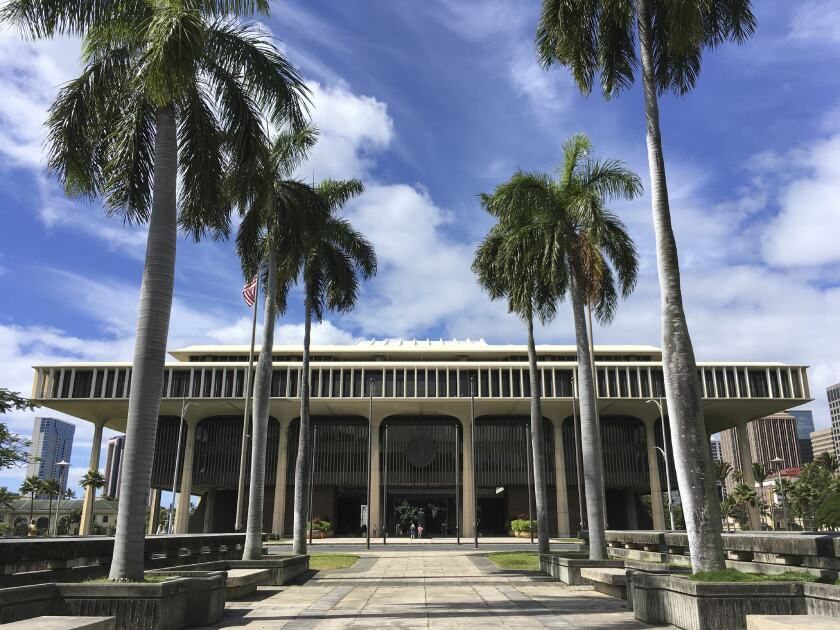 FILE - This March 1, 2019 file photo shows the Hawaii State Capitol in Honolulu. The Hawaii Senate is considering a bill that would impose a 16% tax on individuals earning more than $200,000, which would be the highest income tax rate of any state in the nation. (AP Photo/Audrey McAvoy, File)