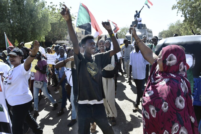 In this Monday, Dec. 23, 2019 photo, Christians march through the streets to celebrate the birth of Jesus in Khartoum Bahri, Sudan, north of the capital Khartoum. More than eight months after the army forced out long-ruling autocrat Omar al-Bashir, who upheld harsh interpretations of Islamic laws, Sudanese Christians are hoping for more religious freedom. (AP Photo/Mohamed Okasha)