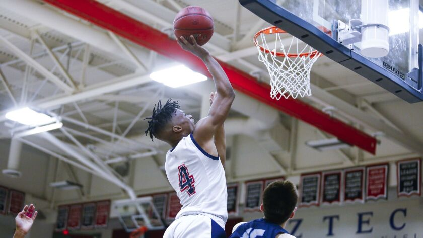 Montgomery's Rahin Williams shoots in the first period against Otay Ranch.