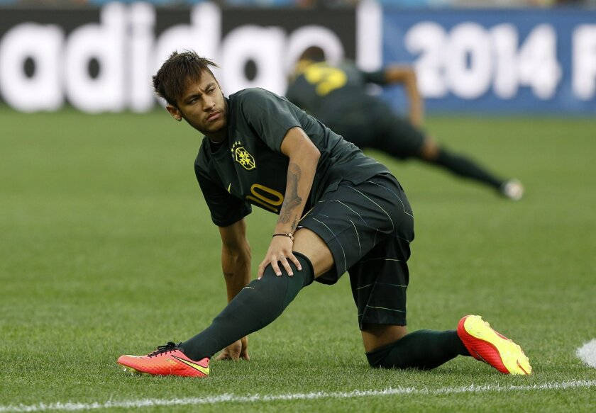 Brazil's Neymar practices during an official training session the day before the group A World Cup soccer match between Brazil and Croatia in the Itaquerao Stadium in Sao Paulo, Brazil, Wednesday, June 11, 2014. (AP Photo/Kirsty Wigglesworth)