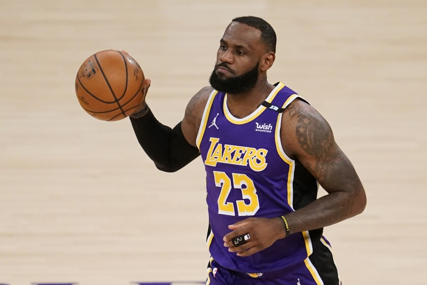 The Lakers' LeBron James dribbles the basketball.