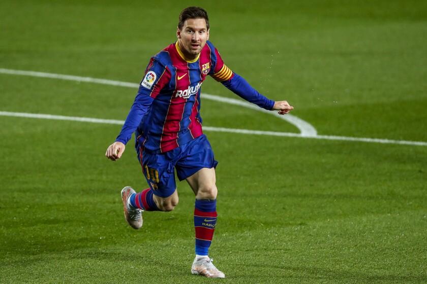 Lionel Messi celebra tras anotar el primer gol del Barcelona