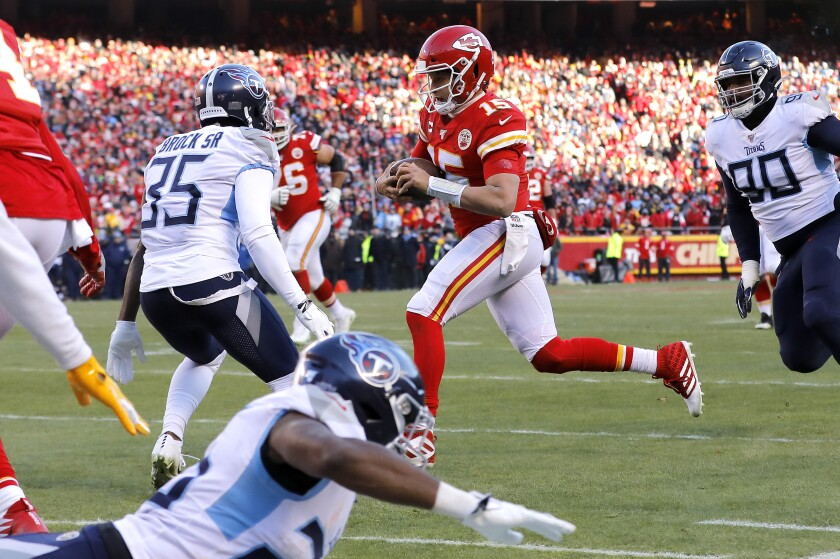 Chiefs quarterback Patrick Mahomes breaks free for a 27-yard touchdown run just before halftime against the Titans on Jan. 19 in the AFC Championship Game at Arrowhead Stadium.