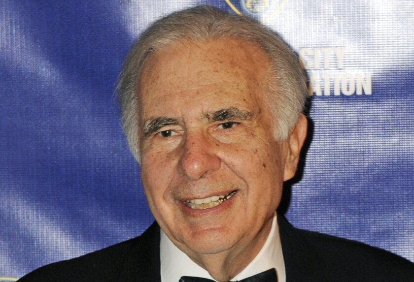 FILE - In this March 16, 2010, file photo, financier Carl Icahn poses for photos upon arriving for the 32nd annual New York City Police Foundation Gala in New York. Xerox announced Friday, Jan. 29, 2016, it is separating into two independent publicly traded companies. The planned breakup follows pressure from Icahn. (AP Photo/Henny Ray Abrams, File)