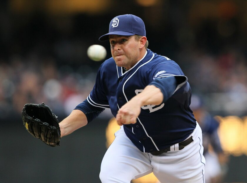 Padres' pitcher Joe Thatcher pitches sidearm. He only lasted part of an inning.