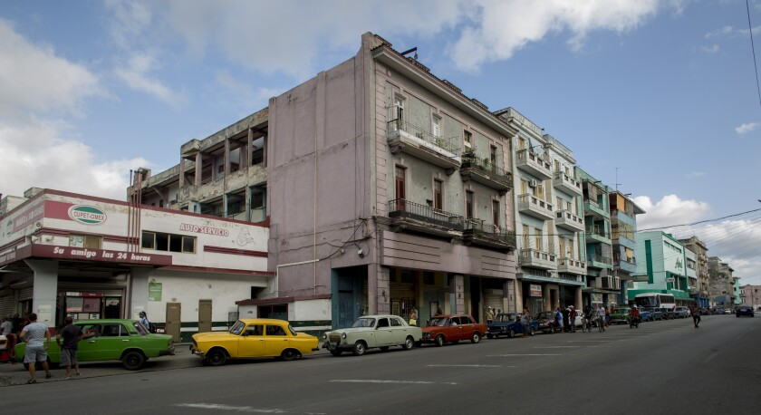 Vehicles wait in a line to fill their gas tanks, in Havana, Cuba, Thursday, Sept. 19, 2019. A fuel shortage blamed on the Trump Administration has turned filling a tank in Cuba into an ordeal even for a country used to waiting in lines. (AP Photo/Ismael Francisco)