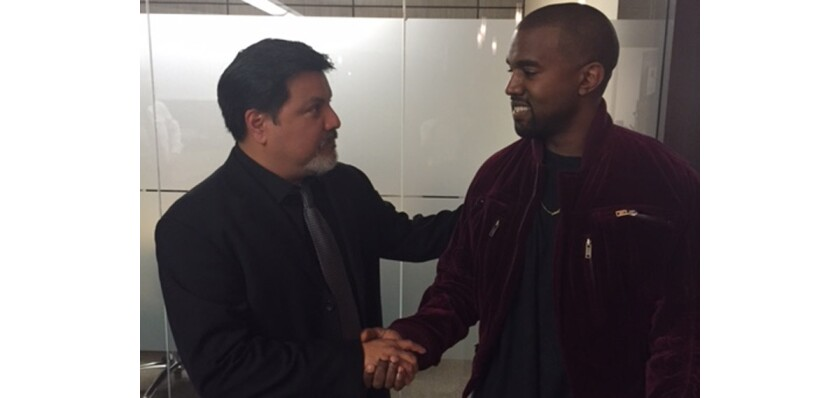 Kanye West, right, apologizes to videographer Daniel Ramos after a lawsuit brought against West by Ramos was settled Tuesday.