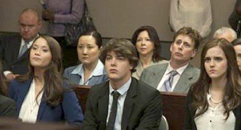 """LAPD Officer Brett Goodkin, far left, appears in the background of a scene from """"The Bling Ring."""""""