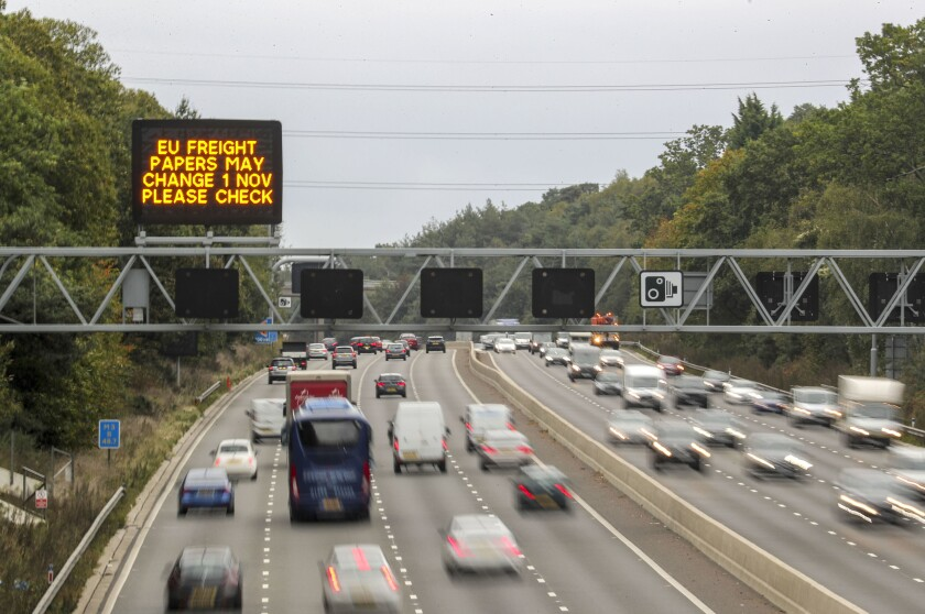 A motorway overhead matrix sign on the M3 motorway warms motorists about possible changes to EU freight papers, near Camberley, south-east England, Monday Sept. 30, 2019. Uncertainty persists over Britain's Brexit split from the European Union bloc, although Britain's Prime Minister Boris Johnson has vowed that Britain will leave on the scheduled date of Oct. 31, with or without a deal. (Steve Parsons/PA via AP)