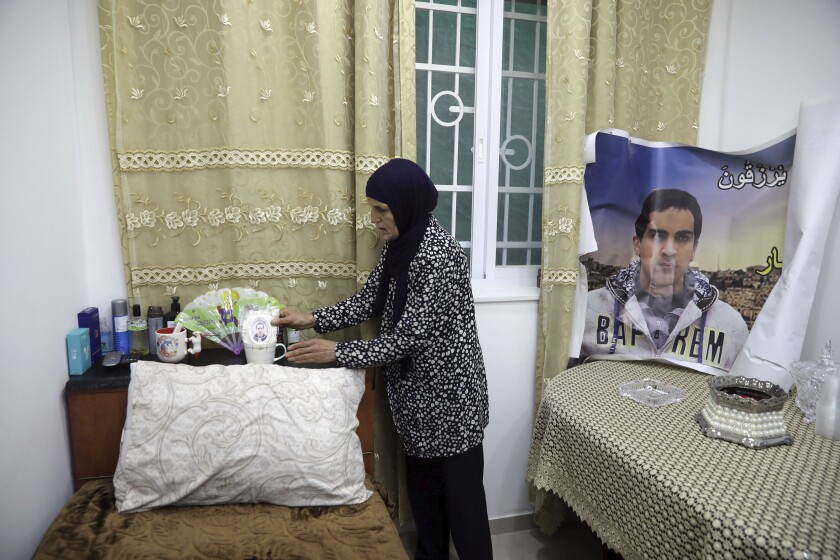 Mother of Iyak Halak, the autistic and unarmed Palestinian killed by Israeli police, arranges his room