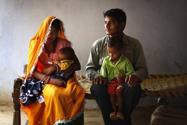 Ramjee Lal Kumhar, right, and wife Mamta hold their toddler son Karan and infant daughter Kusum in their village in India's northern state of Rajasthan. The couple are part of the largest generation in history -- 3 billion people under the age of 25. With so many entering or already in their reproductive years, the impact on the planet will be huge.