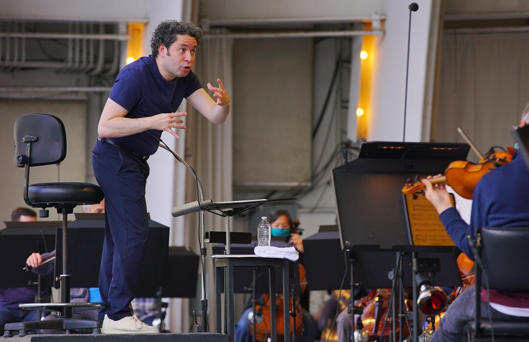 Dudamel gestures as he conducts rehearsal