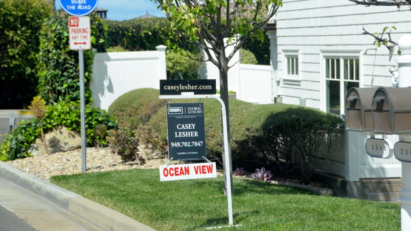 """A home-sale sign that says """"Ocean View"""""""