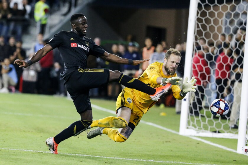 Seattle Sounders goalkeeper Stefan Frei makes a save against LAFC forward Adama Diomande.