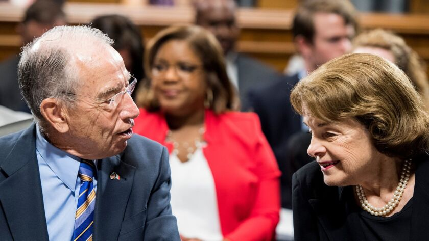 Sens. Charles E. Grassley (R-Iowa) and Dianne Feinstein (D-Calif.), who both serve on the Senate Judiciary Committee, converse in June.