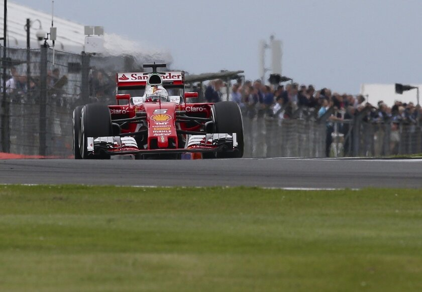Ferrari driver Sebastian Vettel of Germany steers his car during the third free practice at the Silverstone racetrack, Silverstone, England, Saturday, July 9, 2016. The British Formula One Grand Prix will be held on Sunday July 10. (AP Photo/Luca Bruno)